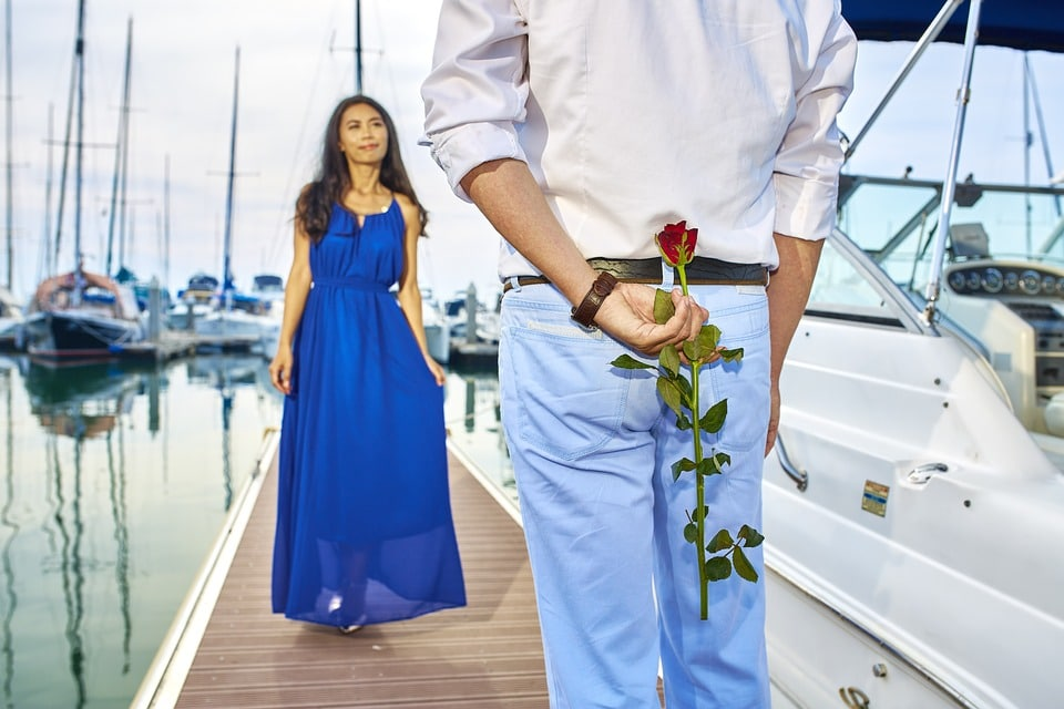 Man Holding Rose for Date